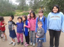 Savannah and Colin with a group of kids in Akiachak